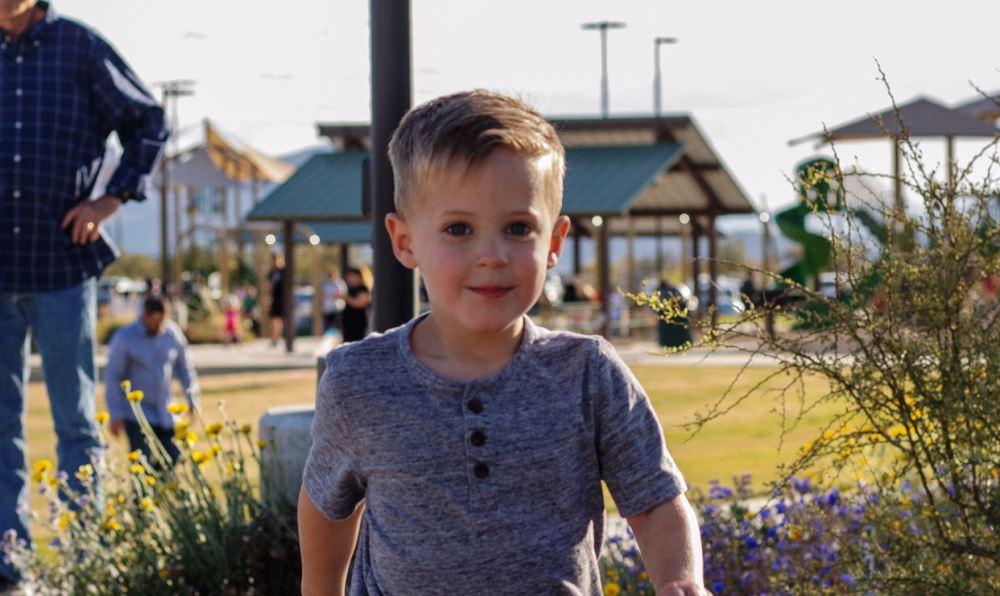Little boy walking in a park